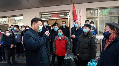In this photo released by Xinhua News Agency, Chinese President Xi Jinping wearing a protective face mask speaks to residents as he inspects the novel coronavirus pneumonia prevention and control work
