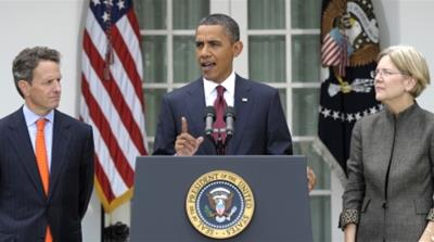 President Barack Obama, accompanied by Elizabeth Warren, right, and Treasury Secretary Timothy Geithner, left, announces that Warren will head the Consumer Financial Protection Bureau, Friday, Sept. 1