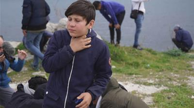 Refugee children amid crowds of protesters tear gassed on Lesbos