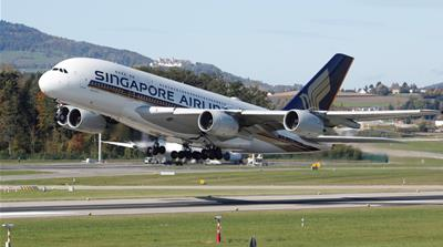 Singapore Airlines shares plunge after posting record loss