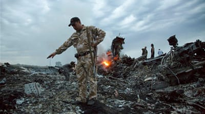 MH17 trial starts with four accused facing murder charges