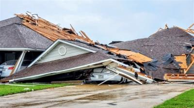 Damaged buildings and vehicles are seen in the aftermath of a tornado in Monroe, Louisiana, U.S. April 12, 2020, in this still image obtained from social media. Courtesy of Peter Tuberville/Social Med