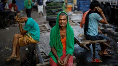 Migrant labourers wait for work at a market in Delhi, India. Informal workers are the world's most vulnerable, and the outlook for them is not bright [File photo: Danish Siddiqui/Reuters]