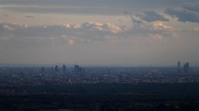 The skyline of Milan is seen at sunset following a pollution reduction caused by the lockdown across the country [Daniele Mascolo/Reuters]
