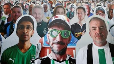 Cutout photos of fans in the stands, following the resumption of play behind closed doors after the outbreak of the coronavirus disease COVID-19 [Thilo Schmuelgen/Pool/Reuters]