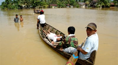 Indonesia floods kill 80