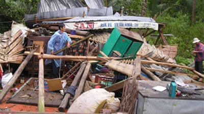 Arroyo decries slow typhoon relief
