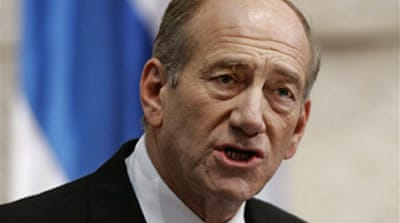 Olmert to face corruption probe