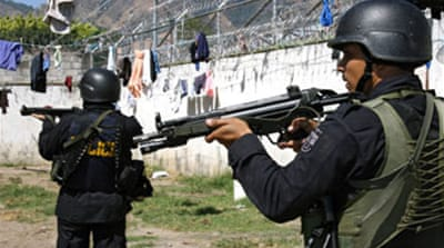 El Salvador prison riots kill 21