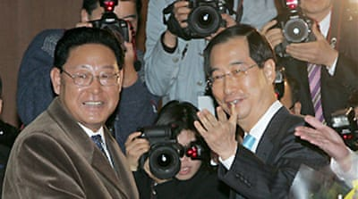 Korean PMs meet for talks