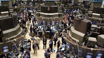 Stock markets slide further
