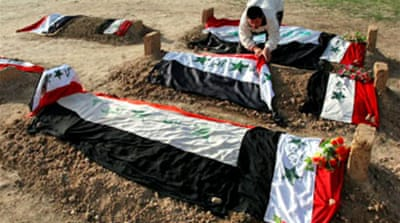 Bodies of Saddam's sons reburied