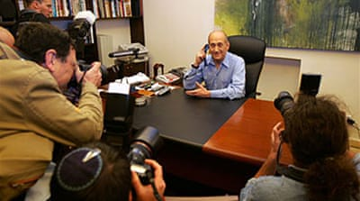 Olmert plays down talk of Gaza raid