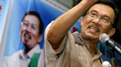 Anwar in party race despite ban