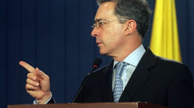Uribe makes Chavez legal threat