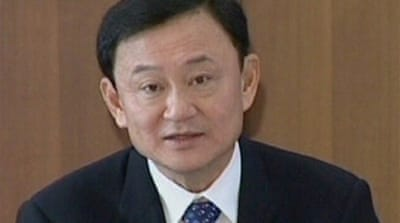 Thailand issues warrant for Thaksin