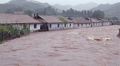 Floods postpone Koreas summit