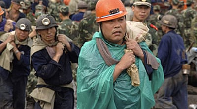 Chinese miners trapped by floods