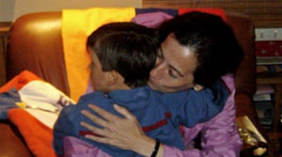 Freed Colombian reunited with son