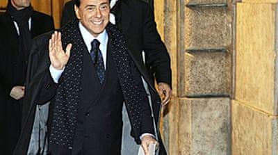 Berlusconi demands early election