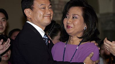 Thaksin's wife returns to Thailand