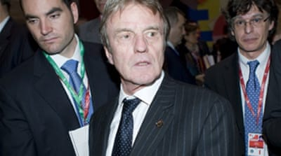 Kouchner backtracks on boycott call
