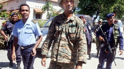 East Timor fighter surrenders