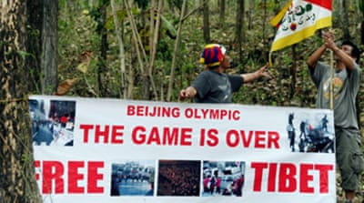 Tibet exiles want torch relay axed