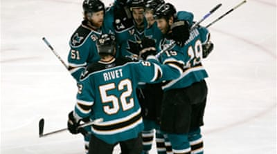 Sharks win to stay alive