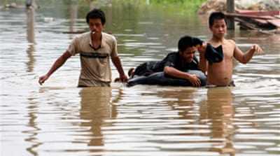 Scores killed in China floods