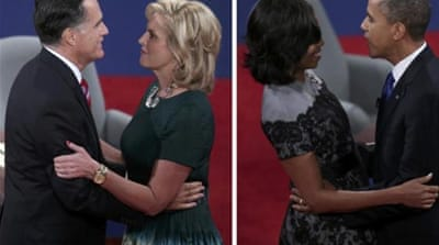 Mitt Romney embracing his wife, as US President Barack Obama embraces first lady Michelle Obama [Reuters]