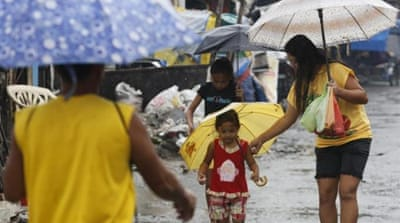 Typhoon Son-Tinh has battered more than 30 provinces in the central, eastern and southern Philippines [EPA]