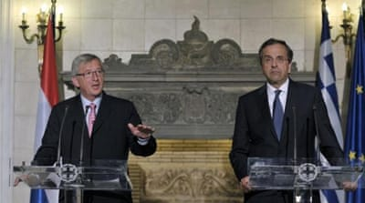 Jean-Claude Juncker, right, has said he is 'totally opposed' to Greece being forced out of the 17-nation bloc [AFP]