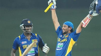 Kiwis need two wins to avoid defeat after Dilshan (R) pushed Sri Lanka to another victory [AFP]