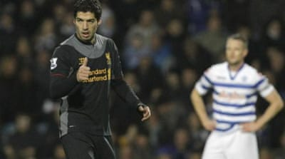 Suarez gave ill manager Brendan Rodgers something to smile about with two goals against a mediocre QPR side [AP]