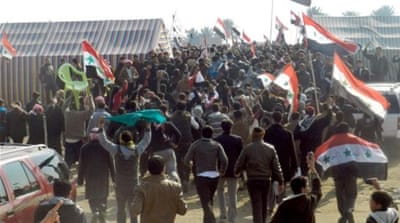 Iraq protesters clash with official's guards