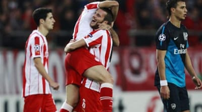 Olympiakos celebrate victory over London team Arsenal - who qualify for next round with group toppers Schalke [Reuters]
