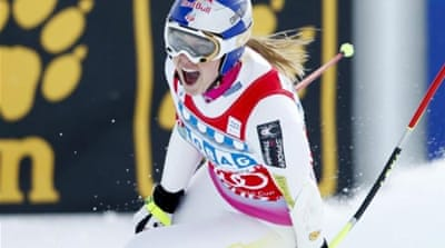 Lindsey Vonn (C) finished just ahead of Tina Maze (L) in the women's World Cup Super-G race [AP]