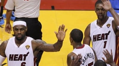 James (R) and Heat teammates are desperate not to follow last year's disappointment with another  [EPA]