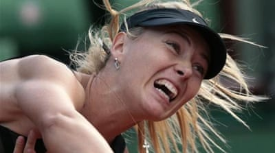 Sharapova enjoys reaching the French Open final and becoming world number one again [AFP]