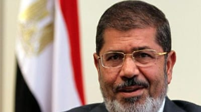 Last week, Morsi ordered parliament to convene in defiance of a military decision to disband the assembly [Reuters]