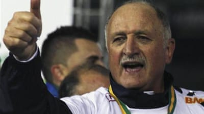 A gleeful Scolari is chucked in the air by his players after he ended a personal 10-year wait for a trophy [REUTERS]