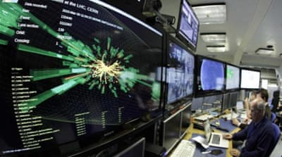A graphic showing a collision at full power is pictured at a control room of the Large Hadron Collider [Reuters]