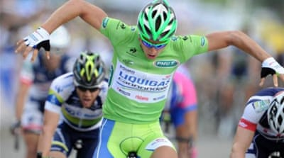 Taking off: Sagan celebrates after beating Greipel to the line [AFP]