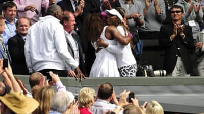 Williams celebrates with Wimbledon trophy after 6-1, 5-7, 6-2 victory over Radwanska [AFP]