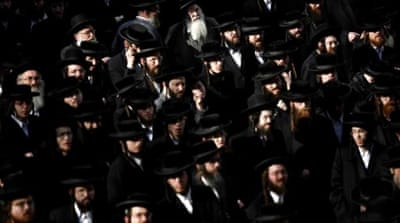 Many ultra-Orthodox men had previously been exempt from army duty to pursue religious studies [Reuters]
