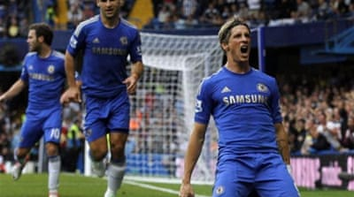 Fernando Torres scores Chelsea's second goal with a swerving shot into the top corner [GALLO/GETTY]