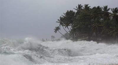 Tropical Storm Isaac pummels Haiti's homeless