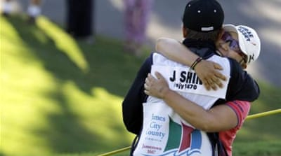 South Korean Jiyai Shin kisses trophy after slim victory over American Paula Creamer [AP]