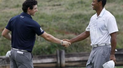 American Jim Furyk (C) will play alongside Tiger Woods (R) against Rory McIlroy (L) at the Ryder Cup [AP]